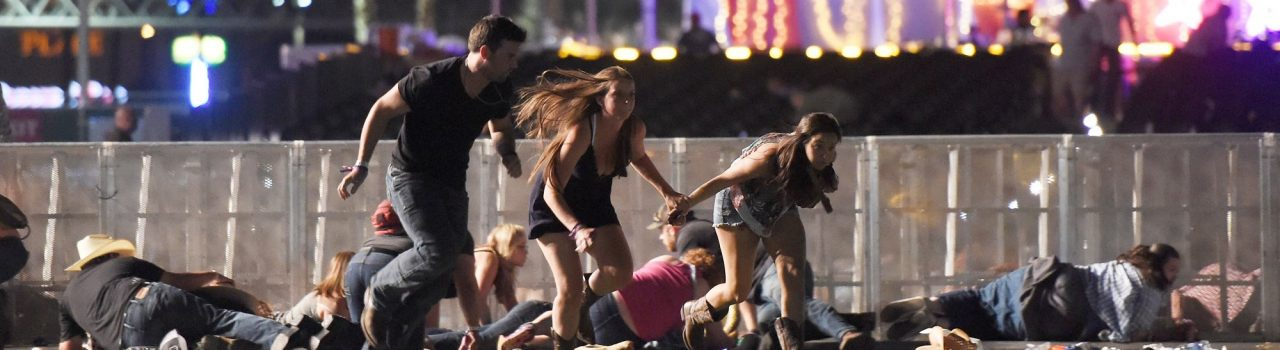 People run from the Route 91 Harvest country music festival after apparent gun fire was heard on October 1, 2017 in Las Vegas, Nevada. There are reports of an active shooter around the Mandalay Bay Resort and Casino.  (Photo by David Becker/Getty Images)